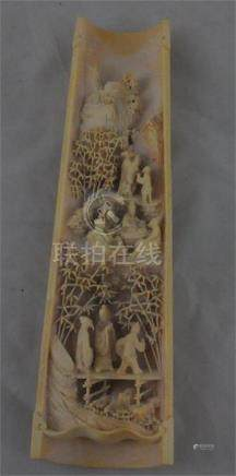 A Chinese curved ivory wrist rest, late Qing dynasty/early republic, circa 1910-20, worked with