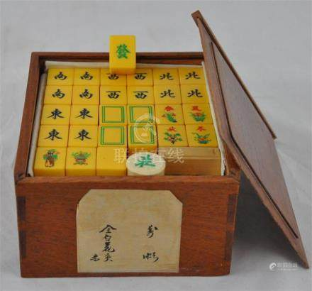 A Mahjong set with ivorine blocks bearing character marks, motifs and conspicuous objects, contained