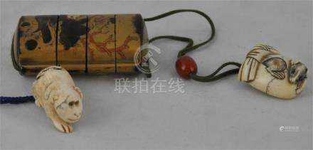 A Japanese Meiji period carved ivory netsuke, of a ratresting upon a pillowwith lacquered Inro