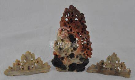 Three Chinese soapstone carvings, late 20th century, one mounted to wood stand. (3)