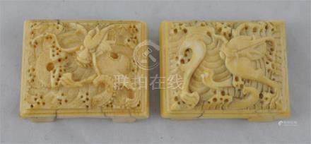 Two Chinese carved ivory belt buckles, late Ming Dynasty, (1368-1674), each with a muscular dragon