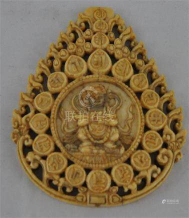 A Tibetan carved and pierced ivory panel of Mahakala, possibly 15th century, the teardrop shaped