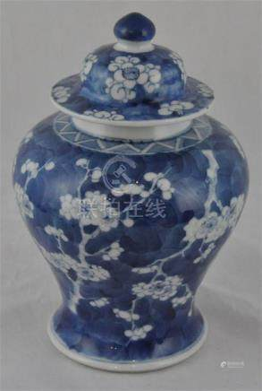 A late 19th century Chinese porcelain Prunus blossom jar and cover, approx 23cms high