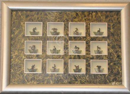 A set oftwelve Chinese metal, mounted zodiac animals on sycee bases, framed, tiger paw missing.