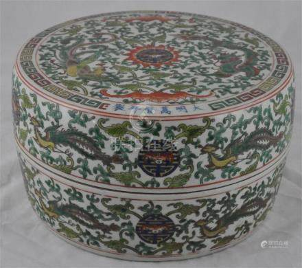 A 19th century Chinese porcelain box and cover in Ming style, profusely decorated with bats, shou
