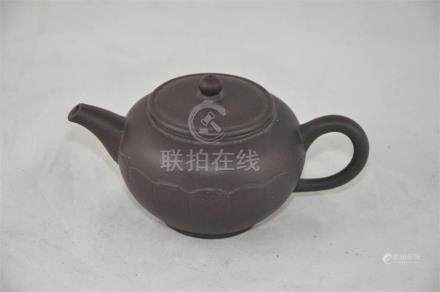 A Chinese Yxing ware teapot, in a dark brown glaze, withseal mark to base, height 7cm. (