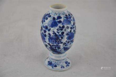 A miniature Chinese blue and white vase, Ching dynasty, early 18th century Kangxi period. Height