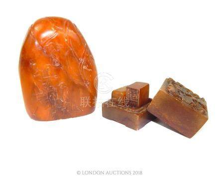 A Chinese amber coloured soapstone carving and a seal