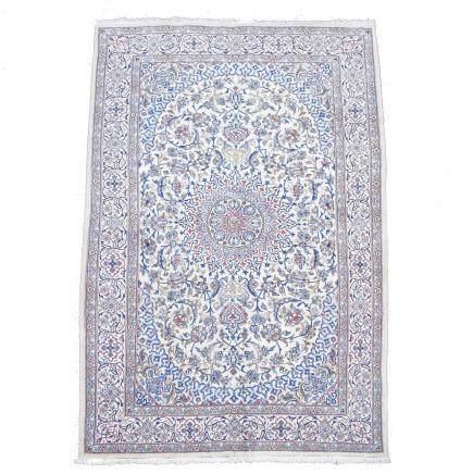 A wool and silk Naein carpet. 297 cm x 194 cm.