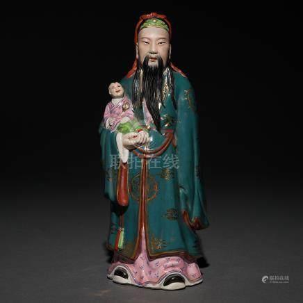 """Inmortal con niño"" Figura en porcelana china. Trabajo Chino, Siglo XX."