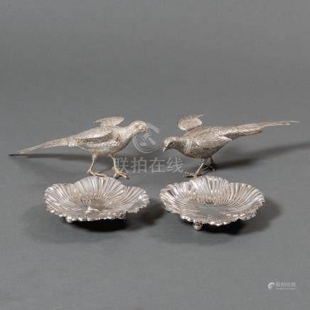 Conjunto de dos faisanes y dos ceniceros en plata española punzonada. Ley, 925. Siglo XX