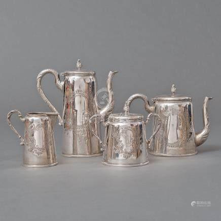 Conjunto de cafetera, tetera, lechera y azucarero en plata española punzonada. Siglo XX
