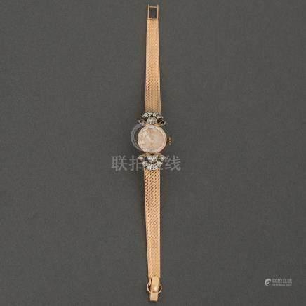 Reloj de Dama en oro amarillo de 18 Kt.