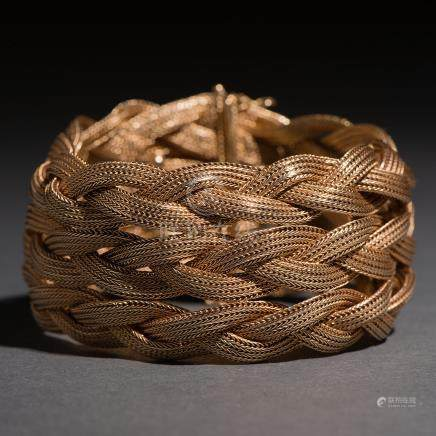 Pulsera ancha entrelaza en oro de malla de 18 Kt.