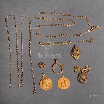 Miscelánea de pìezas de oro amarillo de 18 Kt.