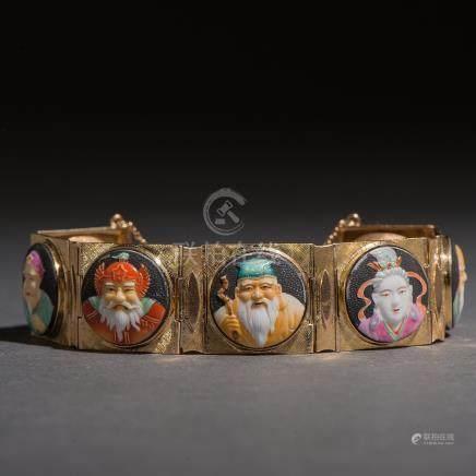 Pulsera en oro amarillo de 18 kt. con 7 sabios de la antigüedad en esmalte.
