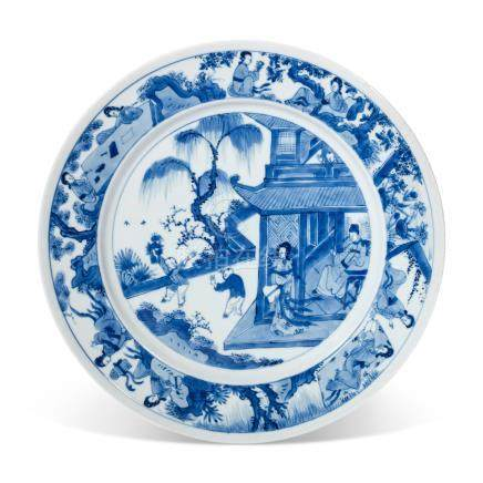 A BLUE AND WHITE 'FIGURAL' DISH