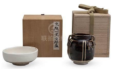 A CIZHOU-TYPE BLACKISH-BROWN-GLAZED RIBBED JAR AND A WHITE-GLAZED SHALLOW BOWL