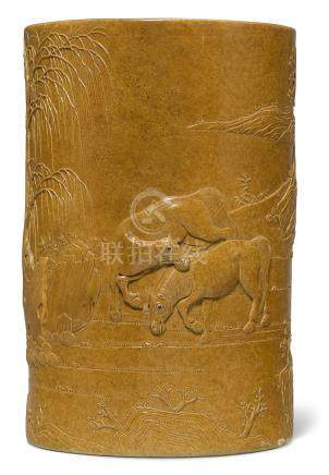 AN AMBER-GLAZED RELIEF-DECORATED BRUSH POT