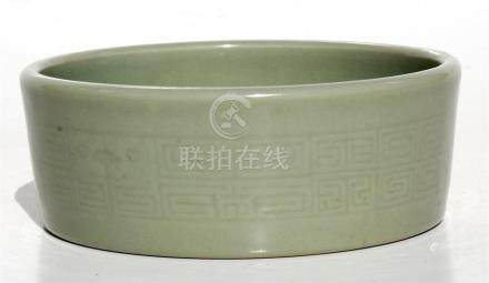 A Chinese celadon glazed brush washer with four character Qianlong mark to underside, 13cms (5ins)