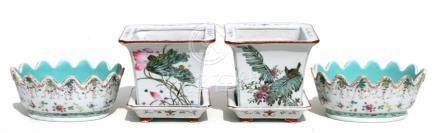 A pair of Chinese famille rose bowls decorated with flowers & butterflies; together with a pair of
