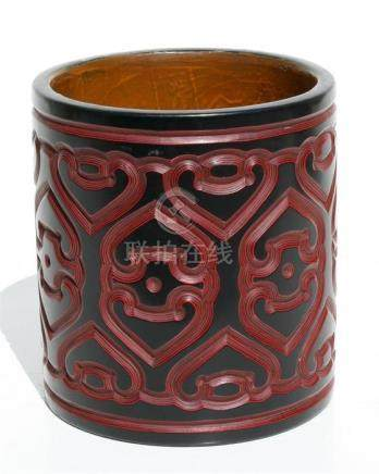 A Chinese cinnabar lacquer bitong brush pot with six character mark to underside, 15cms (6ins)