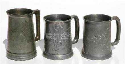 Three Chinese pewter tankards, each decorated with dragons, the largest 14.5cms (5.75ins) high (3).