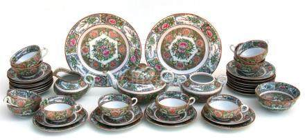 A Chinese Canton famille rose tea service decorated with insects and flowers.