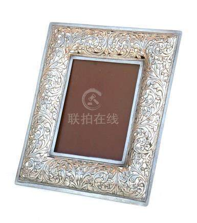 A Chinese pierced silver strut photograph frame, 16 by 19cms (6.25 by 7.5ins) overall.