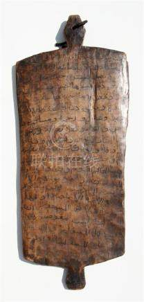An olive wood panel decorated on both sides with Islamic script, possibly extracts from the Koran,