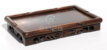 A Chinese hardwood rectangular stand, 36cms (14.25ins) wide.