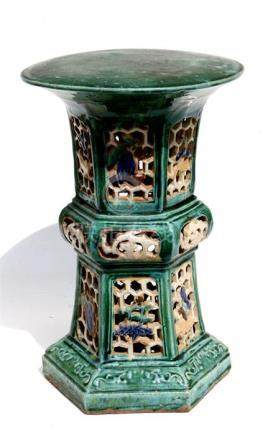A Chinese Sancai glazed garden seat, 52cms (20.5ins) high.