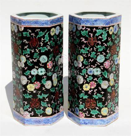 A pair of Chinese hexagonal form famille noir vases decorated with flowers, 28cms (11ins) high.