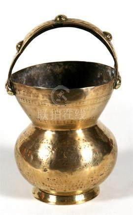 A Turkish / Islamic brass spittoon with calligraphy to the upper rim, 23cm (9ins) high.