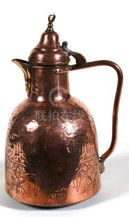A Turkish copper coffee pot decorated with foliate scrolls and calligraphy, 28cm (11ins) high.