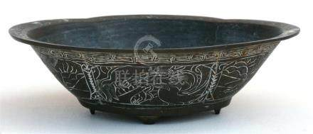 A Chinese bronze bowl decorated with dragons and having a six character mark to underside, 21cms (