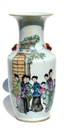 A Chinese vase decorated with figures and calligraphy, with lion mask handles, 43cms (17ins) high (