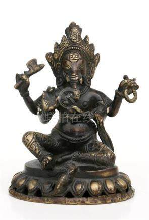 A Tibetan bronze figure of Ganesh, 14cms (5.5ins) high.