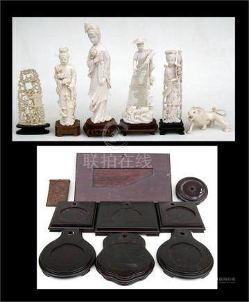 A group of Chinese ivory carvings depicting figures and animals, the largest 20cms (8ins) high;