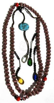 A Chinese Buddhist mala bead necklace with 108 cats eye agate beads.
