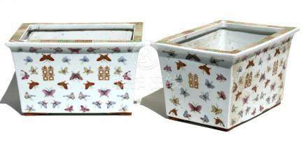 A pair of Chinese rectangular form planters decorated with butterflies in enamel colours with gilt