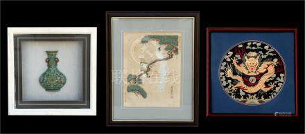 A Chinese circular silk embroidered panel depicting a dragon chasing a flaming pearl, framed &