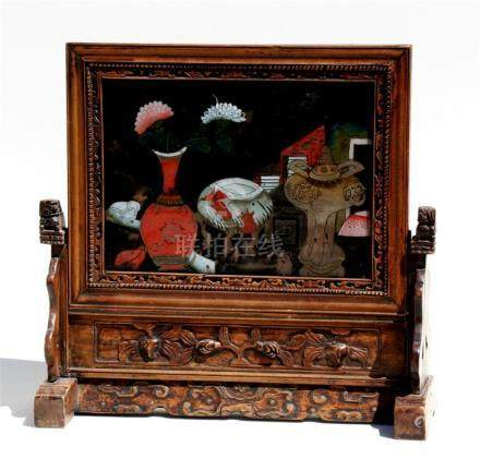 A Chinese reverse painting on glass depicting vases & flowers, mounted in a hardwood frame &