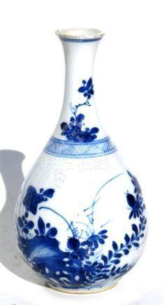 A small Chinese blue & white bottle vase decorated with flowers and butterflies, 14cms (5.5ins)
