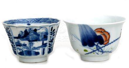 An 18th century Chinese blue & white cup decorated with landscapes & flowers, 8.5cms (3.25ins)
