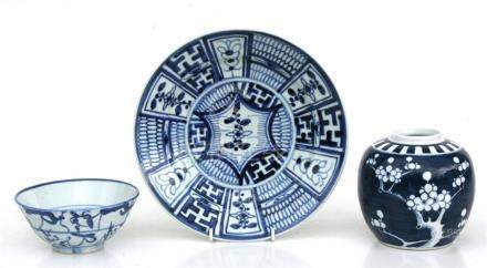 A Japanese Arita blue & white bowl decorated with a figure and birds, 22cms (8.75ins) diameter (a/