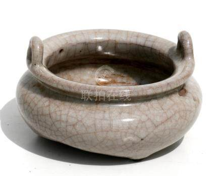 A Chinese crackle glaze two-handled censer of compressed circular form, 12cms (4.75ins) diameter.