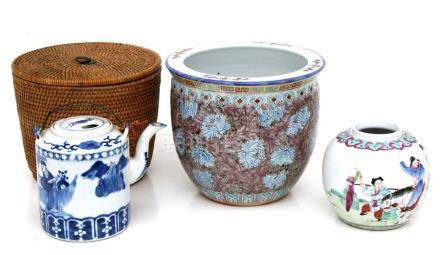 A Chinese blue & white teapot decorated with figures, 14cms (5.5ins) high in a wicker carry case;