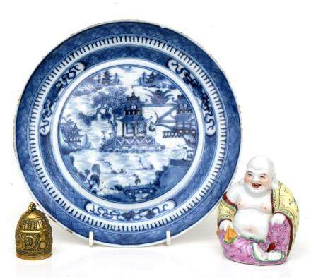 A 19th century Chinese blue & white plate decorated with figures within a landscape, 25cms (9.75ins)