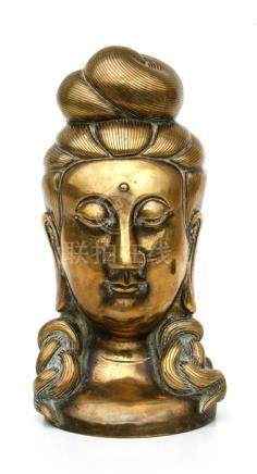 A Chinese bronze bust in the form of Guan Yin, 21cms (8.25ins) high.